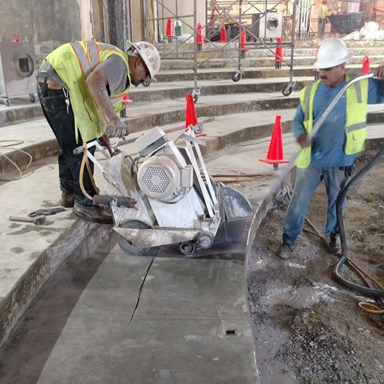 crew cutting concrete